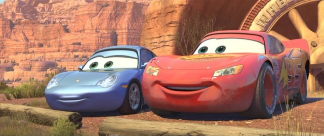 "Sally Carrera and Lightning McQueen take a moment to survey the beauty of Route 66 in Disney/Pixar's ""Cars."""