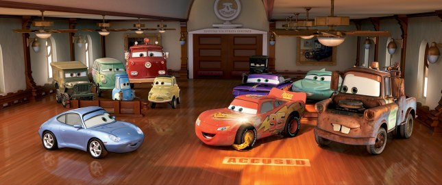 "Lightning McQueen, the accused flashy red racecar, sits between Sally (left) and rusty but trusty tow truck Mater (right) in Disney/Pixar's seventh feature-length collaboration, ""Cars."""