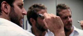 Bearded, hornet-loathing psychologist Doug (Bradley Cooper) gets a close look at one of the bugs on the end of a Q-tip.