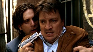 Castle finds a gun pointed at his face in the first episode's climax.