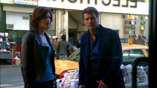 "Beckett (Stana Katic) and Castle (Nathan Fillion) notice an electronic store's window display camera, whose placement might just aid their ""Always Buy Retail"" investigation."
