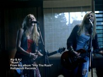 "Aly & AJ ""Rush"" in their successful music video, which has been included as a bonus."