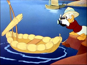 Lake Titicaca tourist Donald Duck takes a snapshot of a boat made from reeds as we hear again of the area's wood shortage.
