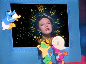 Neon arrows point to the head of Dora Luz, as her singing holds the attentions of Jose, Panchito, and, most of all, Donald. Still from The Three Caballeros: Gold Collection DVD - click to view screencap in full 720 x 480.