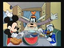 "Mickey, Goofy, and Donald enjoy some breakfast on the road in ""Mickey's Trailer."""