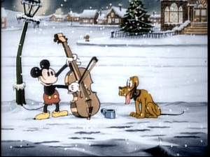 "Mickey and Pluto brave the snowy cold (and colorization) to make Christmas Eve music in ""Mickey's Good Deed."""