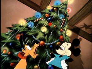 Mickey stands proud of his Christmas tree, but Pluto is troubled by the chipmunks within.
