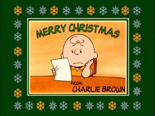 "The short segments of ""Charlie Brown's Christmas Tales"" are introduced by character cards like this bordered blockhead one."