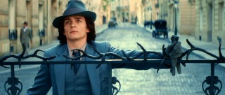 Holding onto the gate to appear casual, Chéri (Rupert Friend) is actually quite curious as to Lea's whereabouts.