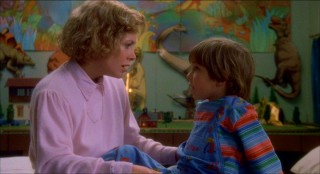 Mother (Catherine Hicks) and son (Alex Vincent) have a heart-to-heart, as they always do in '80s horror films. None of the Camden kids ever got in this kind of trouble!