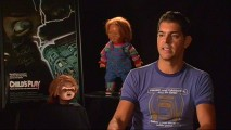 "With Chucky and spare head keeping watch behind him, writer Don Mancini is sure not to embellish the story of production for ""Evil Comes in Small Packages."""
