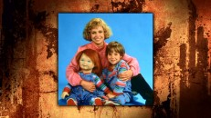 Catherine Hicks, Alex Vincent, and Chucky pose looking like a warm, fuzzy '80s sitcom family in this photo gallery still.
