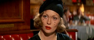 Evelyn Mulwray (Faye Dunaway) dresses the part of grieving widow, but whether she feels it too is less certain.