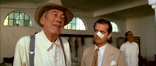 Though he appears in just two scenes, John Houston's loathsome, powerful character Noah Cross was deemed one of cinema's all-time greatest villains by the American Film Institute in 2003. (Meanwhile, an attentive Jack Nicholson rocks out in his nose bandage.)