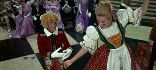 Caractacus (Dick Van Dyke) and Truly (Sally Ann Howes) break into the Baron's castle and perform a number disguised as birthday presents.