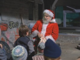 Billy and the kids hang with Santa in a rough, graffiti-covered neighborhood.