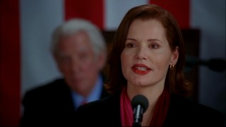 "Geena Davis plays Mackenzie ""Mac"" Allen, the first female President of the United States. In the background, Speaker of the House Nathan Templeton (Donald Sutherland) looks on."