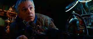 Inventor Loris Harrow (Tim Robbins) pokes up from his tinkering to hear his son share a discovery.