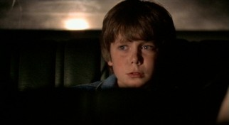 Child actor Harley Cross claims third billing as 9-year-old back seat abductee Travis Knight, who looks for escape opportunities.
