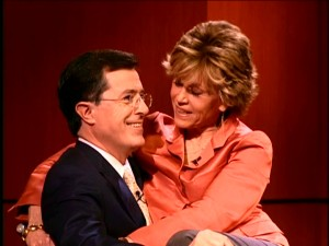 Jane Fonda takes the offer to appear on 'Stephen Colbert' literally, as she sits on the Report host's lap.