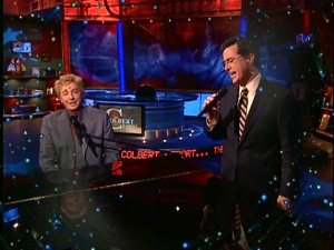 "Patching things up over their Emmy clash, Barry Manilow and Stephen Colbert treat the world to a duet of ""I Write the Songs."""
