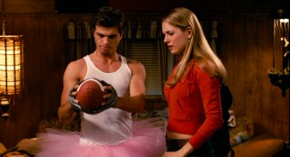 The Comebacks' star quarterback (Matthew Lawrence), who uses duct tape to practice holding onto the ball, has as a love interest the coach's rebellious gymnast daughter (Brooke Nevin).