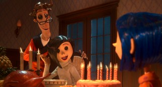 "With the warm glow of a hot meal and cake candles, Coraline is able to overlook the button eyes of her ""other"" Father (John Hodgman) and Mother (Teri Hatcher)."