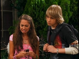 "Newt (Jason Dolley) joins Meena (Maiara Walsh) for some cell phone ""Cory in the House"" viewing."