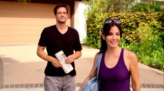 "Divorced Florida real estate agent Jules Cobb (Courteney Cox) shares a moment with her neighbor Grayson (Josh Hopkins), who is developed from newspaper buddy to guitar-playing bartender and more in ""Cougar Town."""