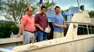 "The leading men of ""Cougar Town"" (Ian Gomez, Josh Hopkins, and Brian Van Holt) enjoy a round of Penny Can on Bobby's landlocked boat ironically titled ""Jealous Much?"""