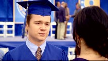 Travis (Dan Byrd) graduates from high school in the Season 1 finale.