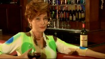 "Barb (Carolyn Hennesy), the show's only real cougar and equivalent of The Todd on ""Scrubs"", sips wine and answers questions suggestively in her web series ""Ask Barb."""