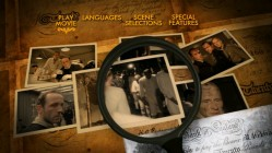 """The Counterfeiters"" DVD's 16x9 main menu changes as the magnifying glass inspects its contents."