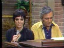 "Liza Minnelli and Fred Ebb enjoy a tune at the piano in a clip from ""The Dinah Shore Show."""