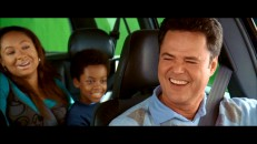 While driving his black friends through a world of bright green, Donny Osmond has a gag reel laugh.