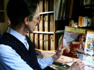 Robert Crumb holds up a copy of Sluts & Slobs magazine, one small piece of his classy magazine collection, in this deleted scene.
