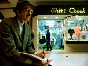 Robert Crumb does some doodling outside a Shirt Creek in this unused shopping mall footage.