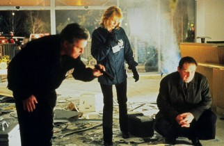 =Gil, Catherine, and Captain Brass look over a crime scene as part of their investigation for clues.