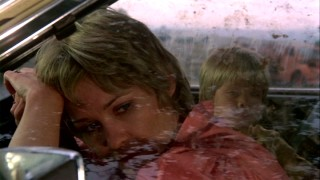 Mother and son are trapped in their dirty, dying Ford Pinto with no food, little water, and one big problem outside.