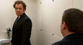 Even at a urinal, John (John C. Reilly) isn't safe from getting caught in the act, as Cyrus confronts him in the bathroom at his ex-wife's wedding.