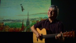 "Former Wings guitarist Laurence Juber blissfully shows off his full fingerstyle rendition of ""A Spoonful of Sugar"" via the Sherman Brothers' Jukebox."