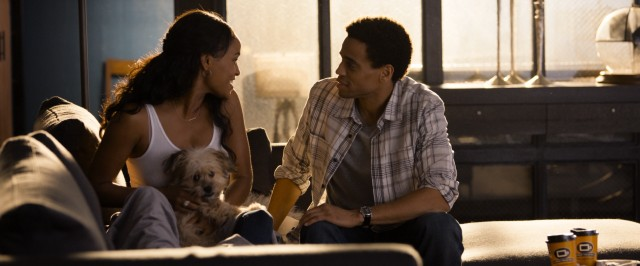 "Debbie (Joy Bryant) and Danny (Michael Ealy), seen here with their dog Pacino, are one of two couples whose relationships are the focus of 2014's ""About Last Night."""