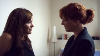 DI Anna Travis (Kelly Reilly) questions Julia Larson (Stine Stengade), the coy Danish wife of the slain former detective.