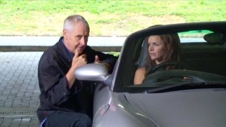 "Gillies MacKinnon directs Danish actress Stine Stengade in a British car on the set of ""Above Suspicion: Deadly Intent."""