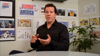 "Jeff Dunham talks about the special in front of a wall of production art in ""The Making of 'Achmed Saves America.'"""