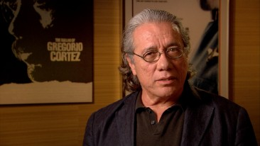 "In front of some Edward James Olmos posters, Edward James Olmos recalls shooting his brief ""¡Alambrista!"" part and the working relationship born out of that."