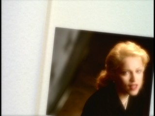 "Madonna sings from the turning pages of a scrapbook in the ""This Used to Be My Playground"" music video."