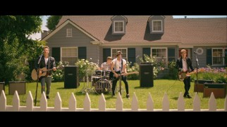 "The Vamps perform ""Hurricane"" on a suburban front lawn inspired by the film."