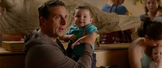 Ben Cooper (Steve Carell) is holding Trevor when the baby utters his first word: fommy.