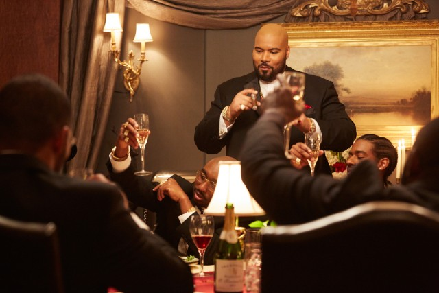 CEO Suge Knight (Dominic L. Santana) welcomes 2Pac (Demetrius Shipp Jr.) to the Death Row Records family in an awkward dinner gathering.